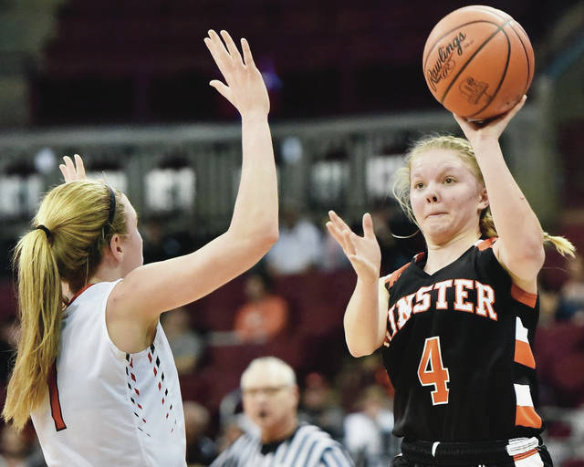 Minster's Ivy Wolf shoots while covered by Cornerstone Christian's Riley Stopp during a Division IV state semifinal on March 15 at the Schottenstein Center in Columbus. Wolf is one of two returning starters for the Wildcats.