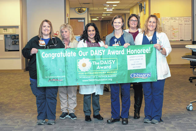 Upper Valley Medical Center DAISY Award winner for November Mandi Crump, third from right, is recognized with the help of coworkers.