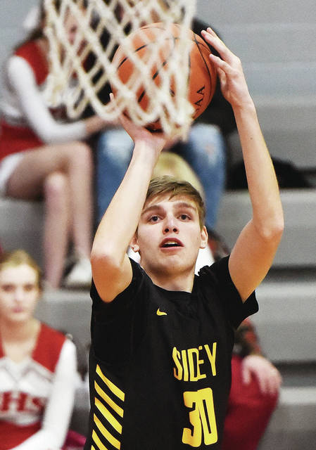 Sidney guard Trey Werntz shoots during a Greater Western Ohio Conference crossover game against Stebbins on Jan. 22 in Riverside. Werntz, who was one of the Yellow Jackets' first players off the bench last year, averaged 3.7 points and two rebounds per game as a junior.