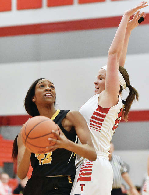 Sidney forward Samantha Reynolds shoots with pressure from Troy's Makenna Taylor during a Greater Western Ohio Conference American North Division game on Jan. 30 in Troy. Reynolds averaged a team-best 10.3 points and 4.8 rebounds per game last year.