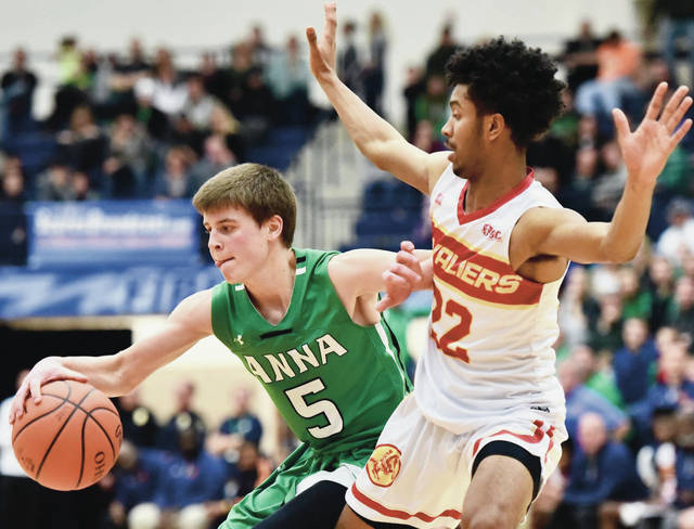 Anna's Isaac Lininger drives against Cincinnati Purcell Marian's Michael Little during a Division III boys basketball regional final on March 16, 2019 at Trent Arena in Kettering. The Rockets' season opener at New Bremen on Saturday will be broadcast by ScoresBroadcast.com. Lininger is one of three returning starters for Anna, which finished 25-3 last season and won a D-III district title.