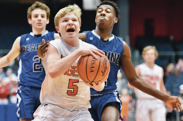 Versailles' Michael Stammen drives as Cincinnati Reading's Allijah Vaught trails during a Division III district final on March 10 at UD Arena. Stammen is one of four returning starters for the Tigers.