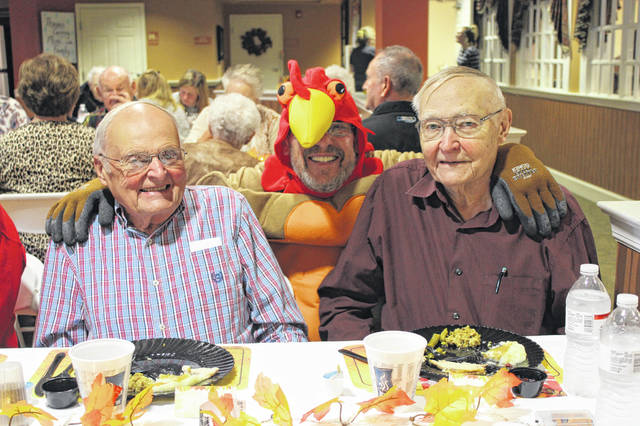 Residents at Elmwood Assisted Living of New Bremen enjoyed a Thanksgiving meal with family this November, with a special visit from Tom the Turkey.