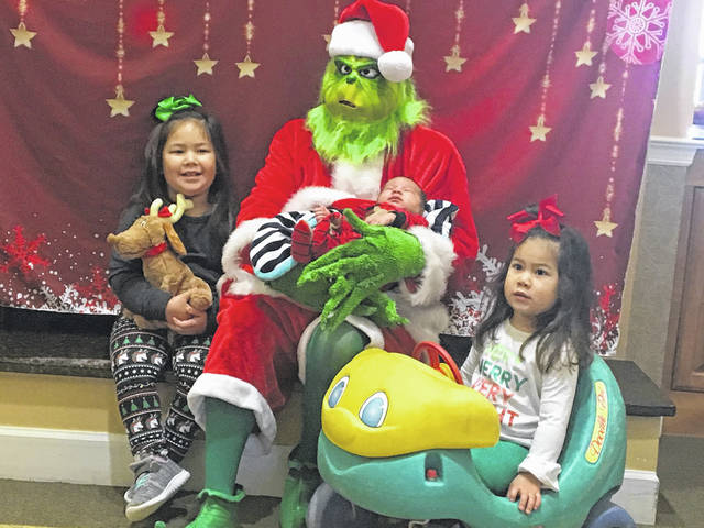 The Grinch recently visited Elmwood Assisted Living of New Bremen and tried to steal the spirit of Christmas from those present. He was unsuccessful as Emerson, Griffin and Emilia Beckman, children of Tom and Lindsay Beckman, helped melt the Grinch's heart so he could enjoy the Christmas season.