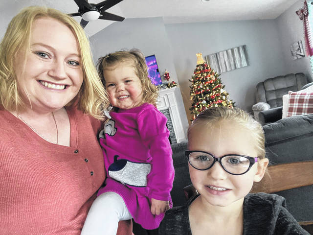 Melissa Holthaus and her daughters, Claire, 2, and Madison, 3, are ready to celebrate their first official Christmas as a family.