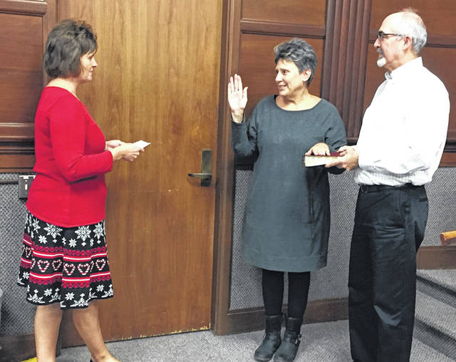 At-large Council member Jenny VanMatre was sworn-in with her husband by her side by City Clerk Kari Egbert during a special Sidney City Council meeting Monday. VanMatre was elected to Council in November. She was appointed to Council in June by City Council after at-large Councilman Joe Ratermann resigned in May.