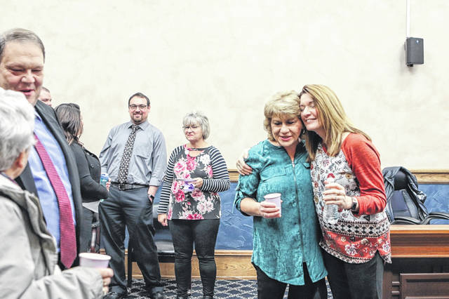 Julie Stewart, of Maplewood, left, hugs Carla Busse, Shelby County Probate Court deputy clerk, during Stewart's retirement party at the Shelby County Courthouse Friday afternoon, Dec. 20. Stewart retired Friday as deputy clerk of the Shelby County Juvenile Court.