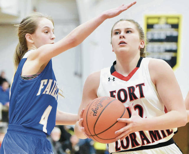 Fort Loramie's Marissa Meiring looks to shoot while covered by Fairlawn's Camri Cundiff during a Division IV sectional final on Feb. 23 at Sidney High School. Meiring, who was named the SCAL player of the year last season, is one of five returning starters for the Redskins. She averaged 10.2 points and 6.3 rebounds per game last season.