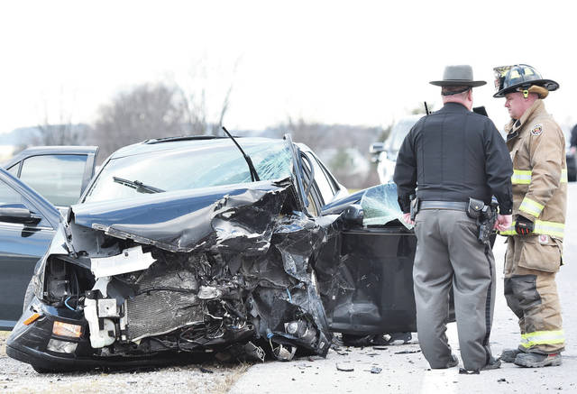 A Shelby County Sheriff's Deputy and a Jackson Center firefighter stand next to a car that collided with another car in the 17000 block of state Route 119 east of Anna around 3:30 p.m. Wednesday, Dec. 4. One person is deceased and one person from a separate vehicle was transported to Wilson Health, according to Shelby County Chief Deputy Jim Frye. Anna Rescue also responded to the crash. No more information is being released at this time.