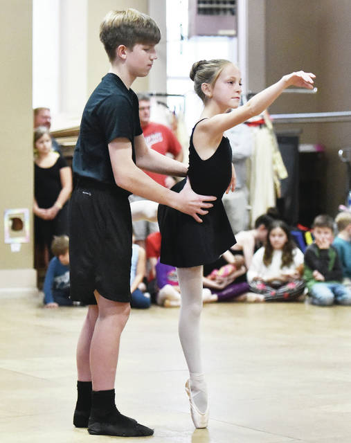 The Prince, played by Dominic Reese, left, 12, son of Gerald and Lisa Reese, dances with Clara, played by Kara Kellner, 13, both of Sidney, daughter of Jennifer and Ken Kellner, during a rehearsal for the Nutcracker at Sharon's School of Dance on Thursday, Dec. 5.