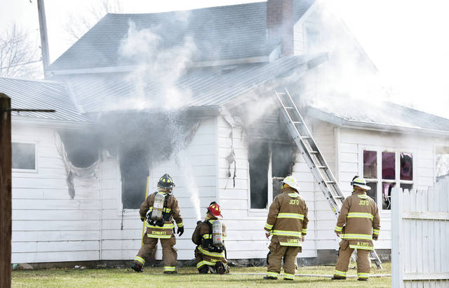 Jackson Center firefighters fight a house fire located at 504 E. College St., Jackson Center, that was reported at 11:53 a.m., Thursday, Dec. 12. Assisting fire departments included Anna, Botkins and Van Buren Township.