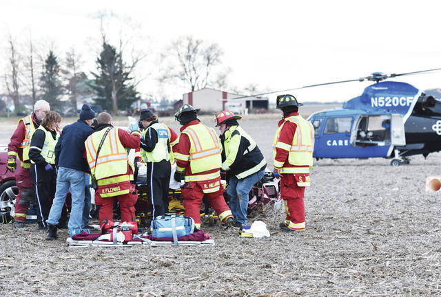 Rescue workers remove a person from a car after a two-vehicle crash as CareFlight waits to take the injured person away in a farm field at the intersection of Tawawa-Maplewood Road and Lefevre Road around 12 p.m. on Friday, Dec. 13. Timothy Robinson, of Quincy,A was pronounced dead at the scene. A second person was taken by CareFlight to Miami Valley Hospital. Lenhart said the people involved from the crash were from Shelby County and Quincy. The Maplewood Fire Department, and Perry-Port-Salem Rescue responded to the scene. The Shelby County Sheriff's Office investigated the crash.