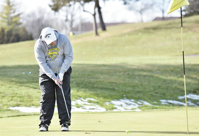 Chris Neth, of Sidney, took advantage of unseasonably warm weather to golf at the Moose Golf Course on Thursday, Dec. 26. While most of the recent snow had melted patches could still be found in shaded areas. Neth said it was also his birthday.