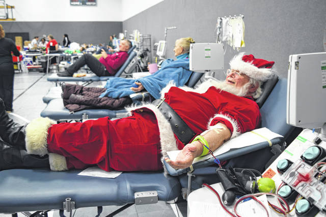 Santa Claus paid a surprise visit to the holiday blood drive held at Sacred Heart of Jesus Parish Knights of Columbus in McCartyville recently. After handing out candy canes to all the donors, Santa rolled up his sleeve to donate blood also.