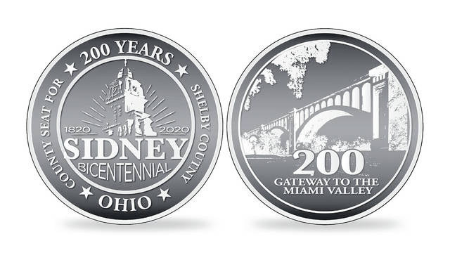 "Sidney's Bicentennial silver coins show the tower of the Shelby County Courthouse on one side and the words ""County Seat for Shelby County"" while the reverse side has the Big Four Bridge and the words ""Gateway to the Miami Valley."""