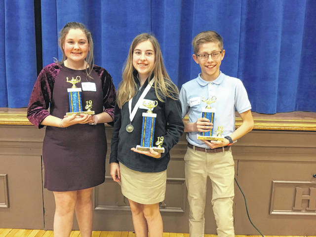 The top three finishers in Holy Angels Geography Bee were, left to right, Eliza Westerheide, third place; Ryan Fitzpatrick, winner; and Brennon Potts, second place.