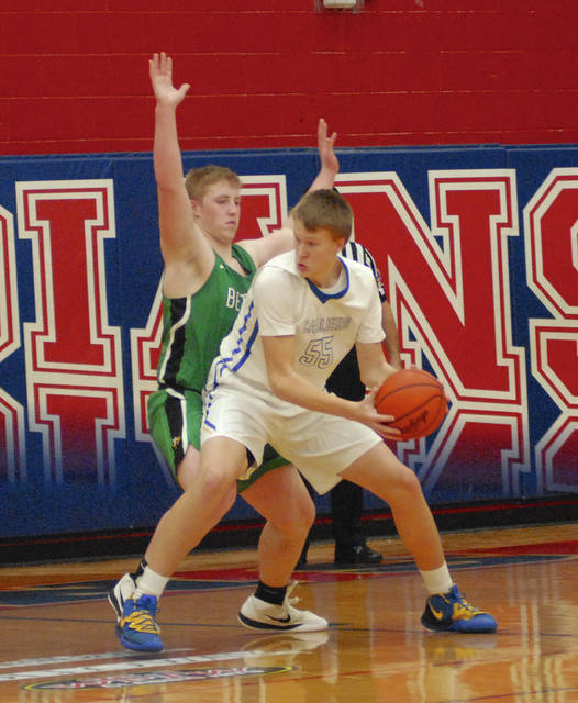 Lehman Catholic's Justin Chapman looks to shoot with pressure from Bethel's Dillon Kelley during the consolation game of the WPTW Classic on Saturday at Garbry Gymasium in Piqua.
