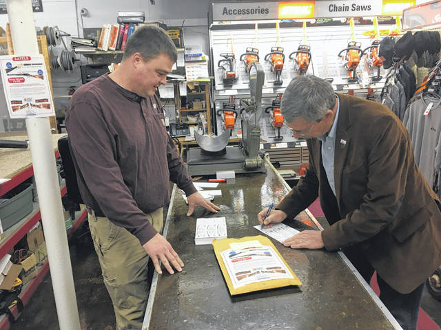 Sidney City Councilmember Steve Wagner purchases raffle tickets from Andy Bratigam at Sidney Ace Hardware Black Friday morning, hoping to win either the Serial No. 1 Henry Golden Boy or the Serial No. 1 Henry Standard Shelby County Commemorative Rifle in next week's drawing. The proceeds of the sale of the raffle tickets will be used to help fund the Shelby County Bicentennial celebration.