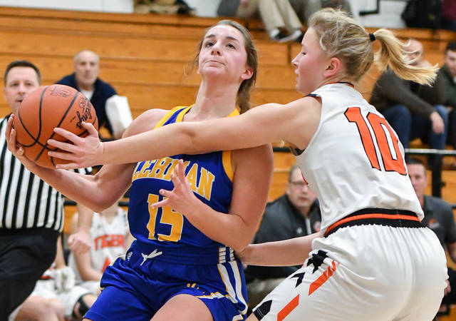 Lehman Catholic junior post Hope Anthony shoots with pressure from Jackson Center's Elena Platfoot during a nonconference game on Thursday in Jackson Center. Anthony scored eight points and had eight rebounds and three steals.