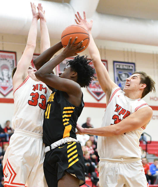 Sidney sophomore forward Avante Martin shoots with pressure from Tippecanoe's Zach Frederick, left, and Griffin Caldwell during the second half of Miami Valley League crossover game on Tuesday in Tipp City.