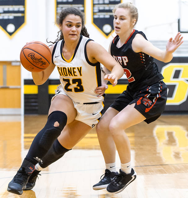 Sidney freshman guard Allie Stockton tries to dribble around Tippecanoe's Kenna Smith during a Miami Valley League game on Saturday in Sidney. Stockton led the Yellow Jackets with 16 points.