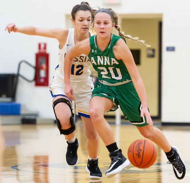 Anna junior guard Ella Doseck dribbles with pressure from Russia's Katelyn Monnin during a Shelby County Athletic League game on Thursday in Russia. Doseck scored a game-high 17 points.