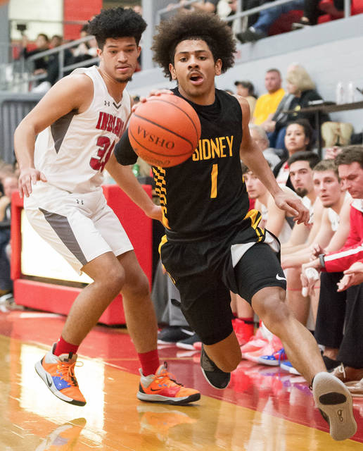 Sidney senior guard Dominick Durr dribbles past Stebbins' Marcus Watson and stays inbounds during the first half of a Miami Valley League game on Friday in Riverside. Durr led the Yellow Jackets with 20 points.