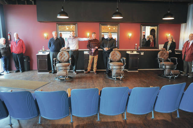 Jacob Cornett, of Sidney, gestures while talking during the ribbon cutting ceremony for his barbershop on Monday, Jan. 13. Standing next to him, left to right, are Sidney-Shelby County Chamber of Commerce President Jeff Raible and barbers Tyler Nation, of Port Jefferson, and Mica Cupp, of Troy. JC's Barber Shop moved from St. Marys Avenue to 1282 Wapakoneta Ave., Sidney.
