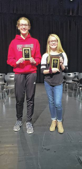 Displaying their awards, runner-up Summer Hoying and champion Avery Bergman will represent Fort Loramie at the regional spelling bee.