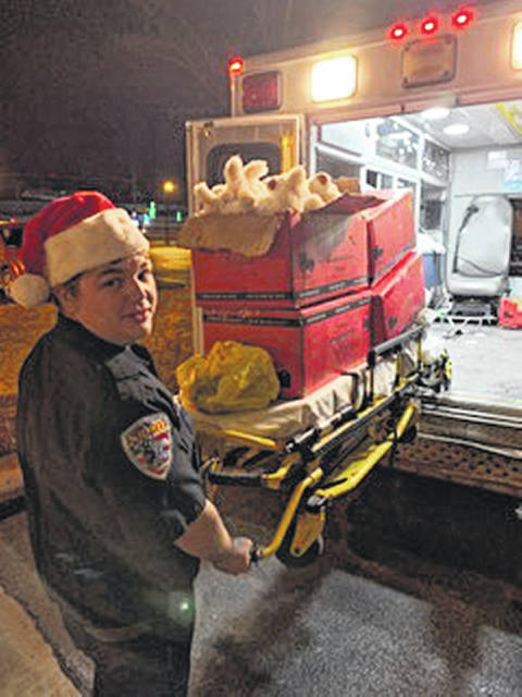 "Ralph Griesdorn uses his ambulance cot as a ""sleigh"" to pass out nearly 200 stuffed animals to area nursing home residents while working his shift Christmas Day at Spirit Medical Transport, LLC."