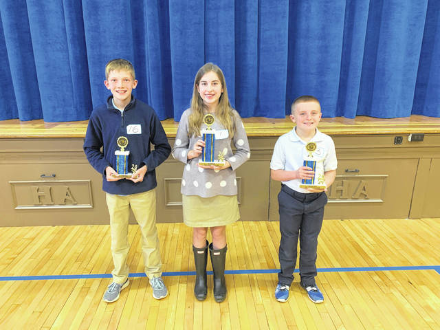 The winners of the Sidney Holy Angels Spelling be, left to right: Colin Potts, third place; Ryan Fitchpatrick, first place; Carter Rigel, second place.