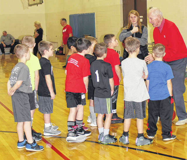 Clinic participants hang on every word as former Dayton Flyer head coach Don Donoher talks to them about basketball.