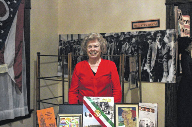 Mary Ann Olding, who was named Shelby County Historical Society's 2019 Historian of the Year, stands in front of a small collection of work she has contributed to and art she has gathered over her career as a historian.