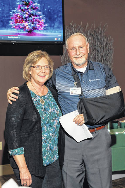 Nita Niekamp, left, is congratulated by Tom Parker, Upper Valley Medical Center president.