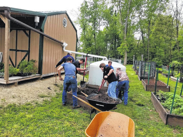 Fairlawn FFA students help with moving a garden bed for The Peoples Garden.
