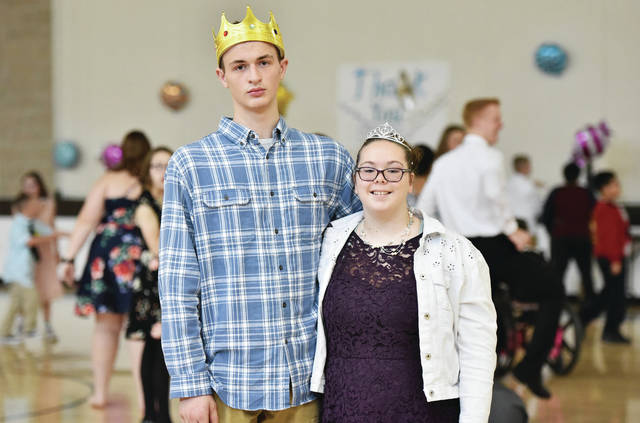Randy Alan Humpherys, left, son of Jason and Sherri Humpherys, was crowned King and Sarah Snider, 14, of Botkins, daughter of Theresa Oren, was crowned Queen of the annual homecoming event for multiple handicapped students at Jackson Center Local Schools on Friday, Jan. 10.