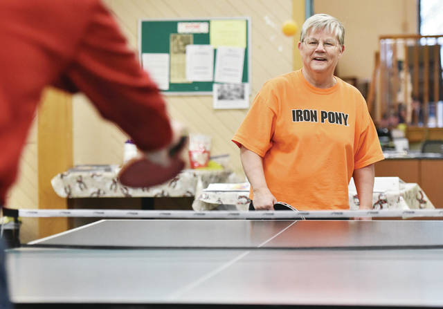 Diann Nussbaum, right, waits for the ball while playing a game of pingpong with Peter Matzig, both of Sidney, at the Senior Center of Sidney-Shelby County on Wednesday, Jan. 15. Nussbaum and Matzig play the game three times a week.