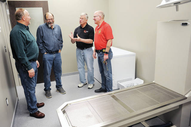 Fraternal Order of Eagles Aerie 1403 trustees Tom Homan, left to right, of Sidney, and Bill Easterlin, of Maplewood, talk with SCARF board member Bob Baird, of Sidney, and Shelby County Sheriff's Office Chief Deputy Jim Frye in a room at the Shelby County Animal Shelter on Saturday, Jan. 18. The room is where Shelby County Dog Warden Kelli Ward, not pictured, hopes to install anesthesia equipment with help from a donation to SCARF by Fraternal Order of Eagles Aerie 1403.