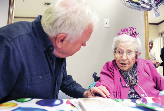 Tom Mann, left, of Jackson Center, wishes his stepmom, Harriett Mann, a resident of Shelby Skilled Nursing and Rehabilitation, a happy 100th birthday on Friday, Jan. 24.