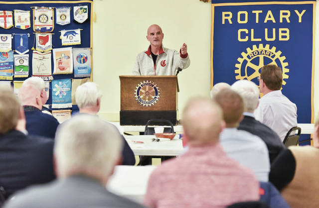Rob Butcher, the vice president of media relations for the Cincinnati Reds, takes questions while talking to the Sidney Rotary Club at the Sidney American Legion on Monday.