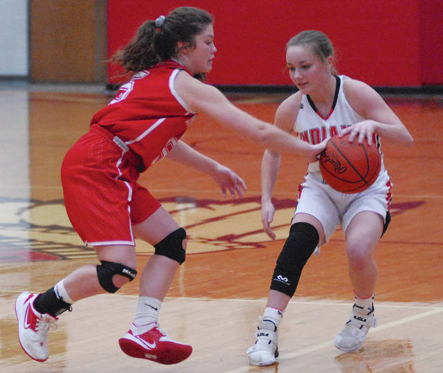 Houston's Megan Maier, left, steals the ball from Newton's Camryn Gleason during a nonconference game on Monday in Pleasant Hill.