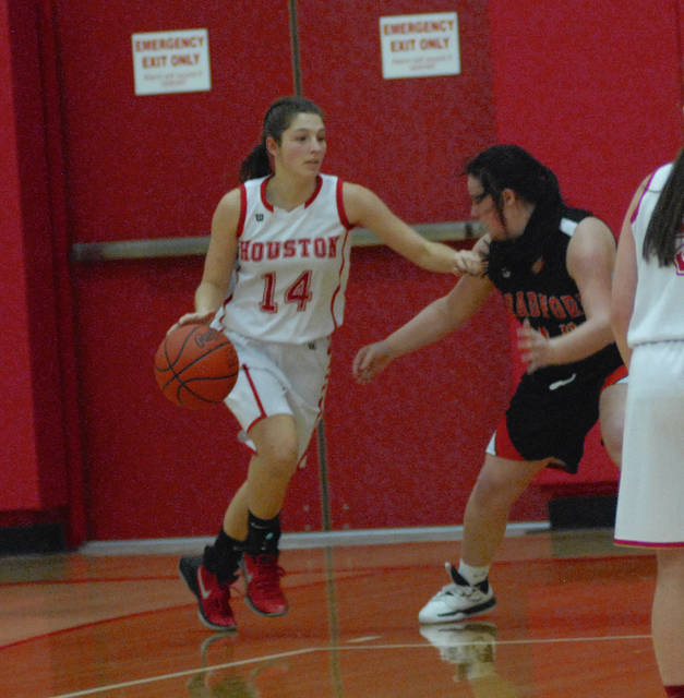 Houston's Mariah Booher dribbles during a nonconference game on Monday in Houston.