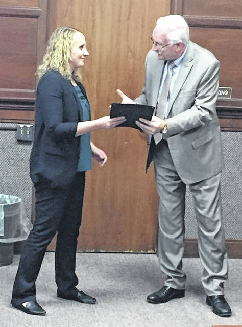 Janel Slonkosky, principal of Holy Angels Catholic School, accepts the proclamtion declaring Jan. 26 to Feb. 1, 2020, to be School Choice Week in the city of Sidney from Mayor Mike Barhorst during Monday's Sidney City Council Meeting.