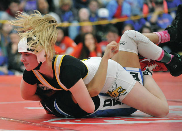 Sidney's Josie Davis looks for a pin against Defiance's Carmela Castaneda in the 126-pound championship match at the first ever OHSWCA girls state wrestling tournament Sunday at Hilliard-Davidson High School.