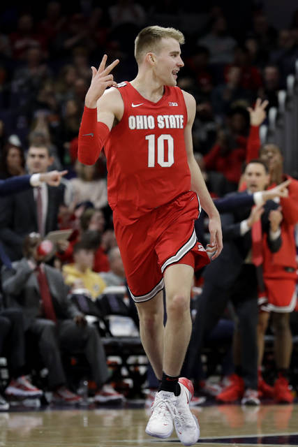 Ohio State sophomore forward Justin Ahrens reacts after making a 3-point basket during the second half of an NCAA college basketball game against Northwestern in Evanston, Ill. on Jan. 26. Ahrens, a Versailles graduate, hit 4-of-5 three-pointers against the Wildcats.