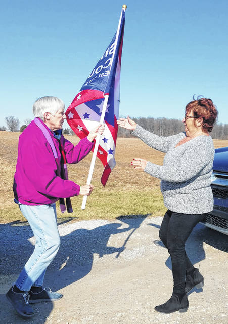 The final run of the Shelby County flag during the yearlong celebration for the Shelby County bicentennial was held Saturday, Feb. 22. Marjorie and Tom Dunnavant, of Sidney, pass the flag to Carlene Pettit, of Piqua. Marjorie's fourth-great-grandfather, John Blake, purchased the first parcel of land in downtown Sidney and opened a tavern in 1820.
