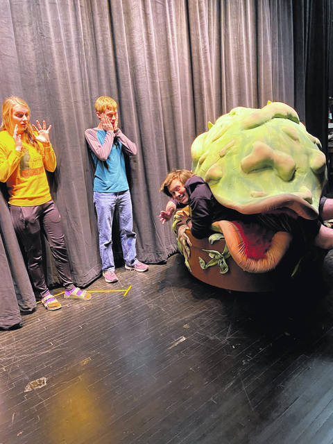 "Rehearsing ""Little Shop of Horrors"" are Caleb Gaier, 18, Anna, son of Barb and Scott Gaier; Cameron Klopfenstein, 17, Jackson Center, son of David and Charity Klopfenstein; and Mackensie Littlefield, 17, Anna, daughter of Brenda and Woody Littlefield. Anna High School will put on the musical March 6-8."