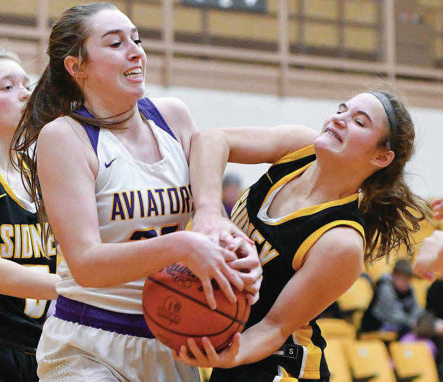 Sidney freshman guard Lexee Brewer fights for a rebound with Vandalia-Butler's Evan Neeley during the second half of a Miami Valley League game on Dec. 14 in Vandalia. The Yellow Jackets lost to the Aviators 53-51 in December but won the team's second MVL matchup 49-41 on Jan. 23. They'll face off in a sectional tournament opener on Feb. 15 in Troy.
