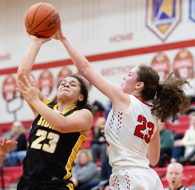 SIdney freshman guard Allie Stoctkon shoots as Tippecanoe's Rachel Wildermuth tries to block during the first half of a Miami Valley League game on Wednesday in Tipp City.