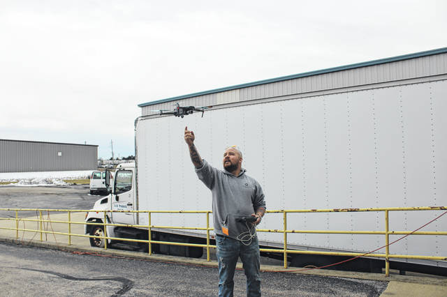 Devin Brautigam, owner of From Above Aerial LLC, gives a demonstration on using drones for photography and videography to members of S&H Products in Sidney on Monday, Feb. 17.